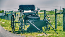 Amish Open Buggy For Sale On Side Of The Road On A Sunny Day