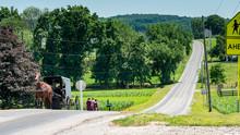 Amish Teenagers Walking Along ...
