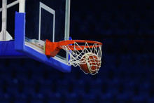 A Basketball Flies Into The Ring. On The Background Of A Sports Complex