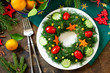 """Winter Christmas salad wreath. Delicious Russian traditional salad """"Olivier"""" with vegetables and meat on the holiday table. Top view flat lay background."""