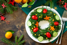 "Winter Christmas Salad Wreath. Delicious Russian Traditional Salad ""Olivier"" With Vegetables And Meat On The Holiday Table. Top View Flat Lay Background With Copy Space."