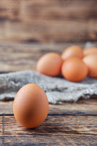 Close up view of brown chicken eggs on wooden table