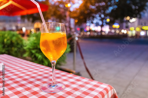 Traditional aperol Spritz aperitif in a street bar at evening Canvas Print