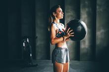 Strong Girl Holding Med Ball A...