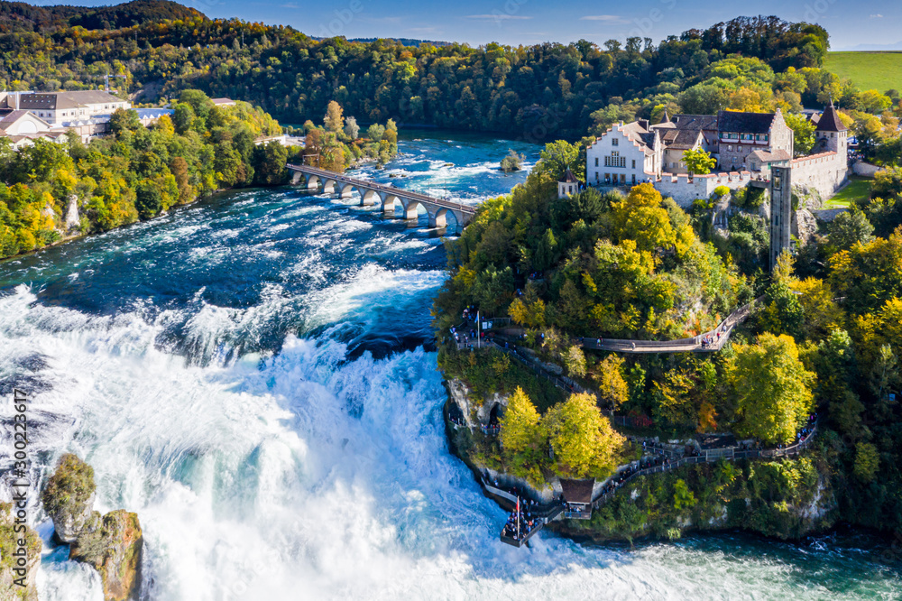 Fototapety, obrazy: Rhine Falls or Rheinfall, Switzerland panoramic aerial view. Tourist boat in waterfall. Bridge and border between the cantons Schaffhausen and Zurich. Cliff-top Schloss Laufen castle, Laufen-Uhwiesen