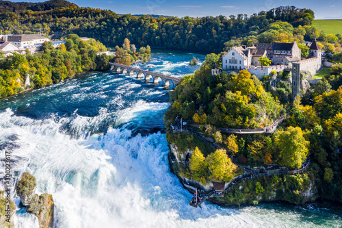 Rhine Falls or Rheinfall, Switzerland panoramic aerial view. Tourist boat in waterfall. Bridge and border between the cantons Schaffhausen and Zurich. Cliff-top Schloss Laufen castle, Laufen-Uhwiesen - 300223617