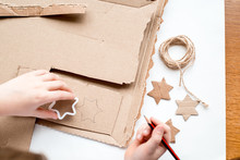 A Child Carves A Star From Car...
