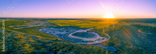 Foto op Plexiglas Purper Agricultural land at sunset in Australia - aerial panoramic landscape