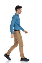 Side View Of Smart Casual Man Smiling And Walking