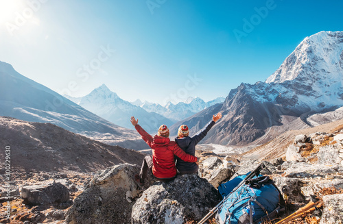 Couple rising arms rejoicing Everest Base Camp trekking route near Dughla 4620m Wallpaper Mural