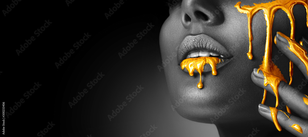Fototapety, obrazy: Gold Paint smudges drips from woman face, lips and hand, lipgloss dripping from sexy lips, golden liquid drops on beautiful model girl's mouth, gold metallic skin make-up. Beauty woman makeup close up