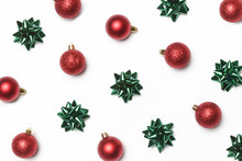 Festive Winter Background. Red Christmas Ornaments And Green Bows Isolated On White Background. Christmas, Winter Holiday, New Year Concept.