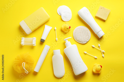 Cuadros en Lienzo Flat lay composition with baby cosmetic products on yellow background