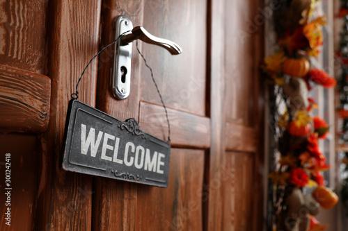 Fotografía Sign with word WELCOME hanging on door