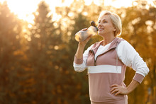 Sporty Mature Woman With Bottl...