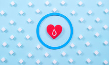 Symbol Of Diabestes With Sugar Cube And Red Heart On Pastel Blue Background. World Diabestes Day Concept.