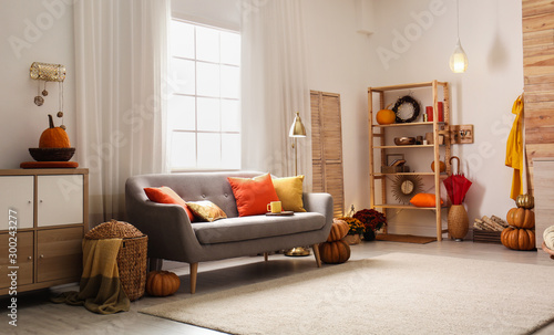Cozy living room interior inspired by autumn colors Fototapeta