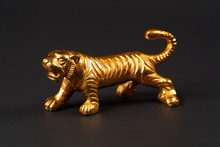 Golden Tiger Toy On Black Back...