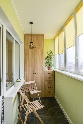 Interior of balcony with green walls, sitting area Wallpaper Mural