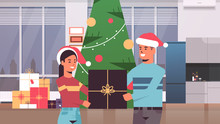 Couple Holding Gift Present Box Merry Christmas Happy New Year Holiday Celebration Concept Man Woman Wearing Santa Hats Standing Near Fit Tree Modern Living Room Interior Horizontal Portrait Vector