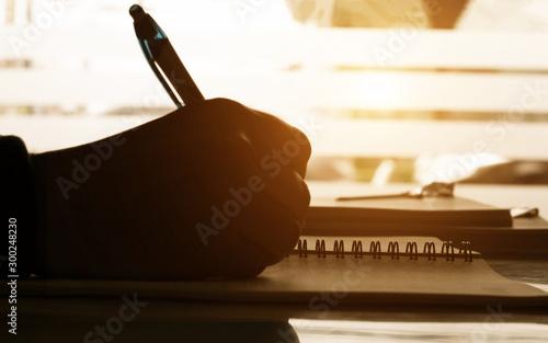 Fotografie, Obraz close up hand writing notes on notbook on desk