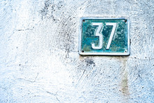 Number 37, Thirty-seven, Blue Blate On Frottage White Background.