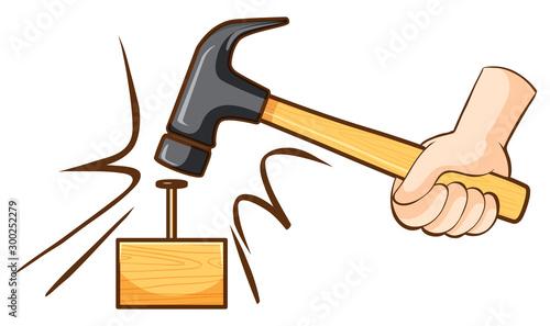 Obraz na plátne Hammer hitting nail on wooden block