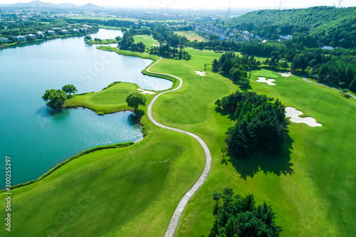 Spoed Fotobehang Weide, Moeras Aerial view of golf course and water