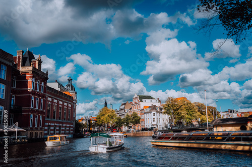 Fényképezés Bright blue sky and fluffy clouds over Amstel in Amsterdam Netherlands, landmark