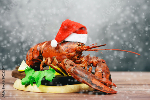 Fresh red lobster with christmas hat shellfish cooked in the seafood restaurant Wallpaper Mural