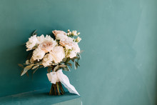 Printing And Decor For A Wedding With Flowers. Modern Bridal Bouquet In Hand.