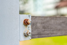 Rusty Nuts And Bolts On Wood F...