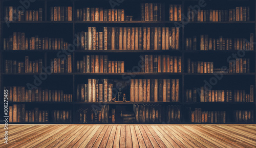 Cuadros en Lienzo blurred bookshelf Many old books in a book shop or library