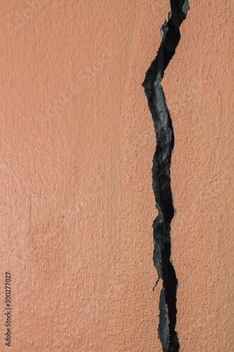 Photo  Orange  cement wall background, crack