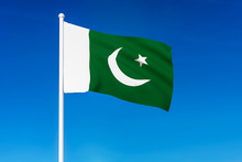 Waving Flag Of Pakistan On The Blue Sky Background