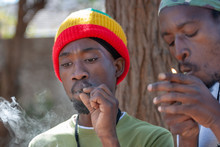 Rasta Preparing A Joint