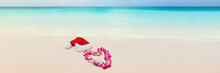 Christmas Beach South Tropical Summer Destination For Winter Holidays Getaway Banner Panorama. Caribbean Beach With Santa Hat And Heart Shape Lei Flower Necklace Hawaii Honeymoon.