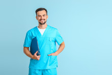 Portrait Of Male Doctor On Color Background