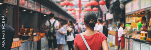 Fototapeta China food market street in Beijing. Chinese tourist walking in city streets on Asia vacation tourism. Asian woman travel lifestyle panoramica banner. obraz