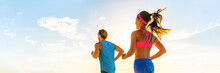 Runners Fitness Couple Running Together On Sunset Sky Background Panoramic Banner. HIIT Workout Athletes People Doing Cardio Exercise.Active Lifestyle.