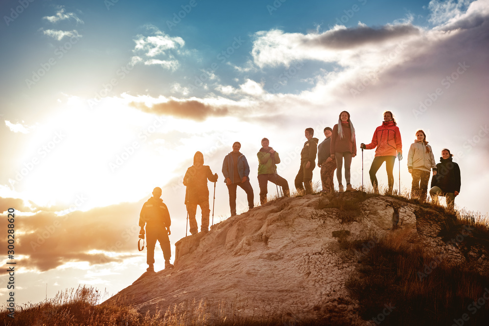 Fototapety, obrazy: Big group of hikers against sunset