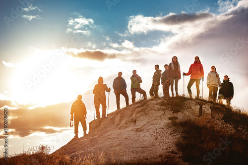 Obraz Big group of hikers against sunset - fototapety do salonu
