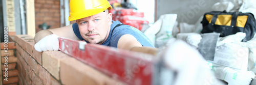 Leinwand Poster Prudent male in hardhat