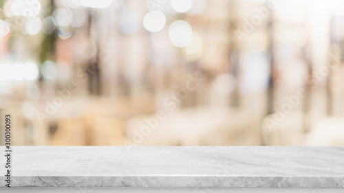 Obraz na plátně  Empty white marble stone table top and blur glass window wall restaurant banner mock up abstract background - can used for display or montage your products
