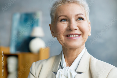Close up image of beautiful mature Caucasian female CEO with bonde pixie hairsty Canvas Print