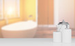 set for the bathroom, toothbrush, jars, a container for liquid soap on a white table. on blurred background