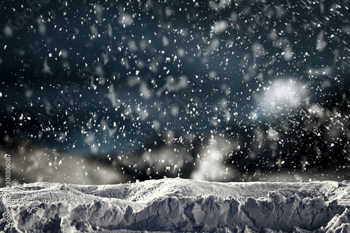 Foto auf Gartenposter Schwarz Snowy winter glimmering and shiny landscape with snowy top for products and decorations or text. White and blue heavy snowing background.