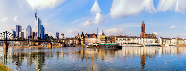 Wide color panorama of the city of Frankfurt am Main,skyscrapers,cathedral,sky clouds, river,bridge,cranes,boats,on s sunny day