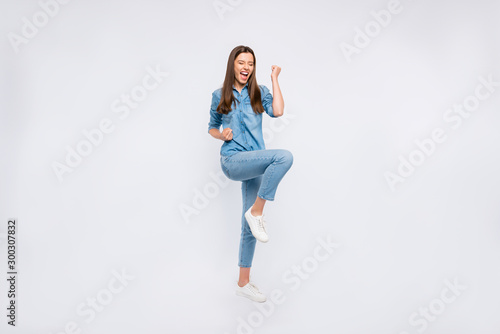 Full length body size view of her she nice attractive lovely ecstatic glad cheerful cheery positive girl having fun rejoicing celebrating attainment isolated over light white color background - 300307832
