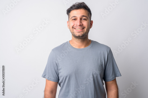 Obraz Portrait of happy young handsome Persian man smiling - fototapety do salonu